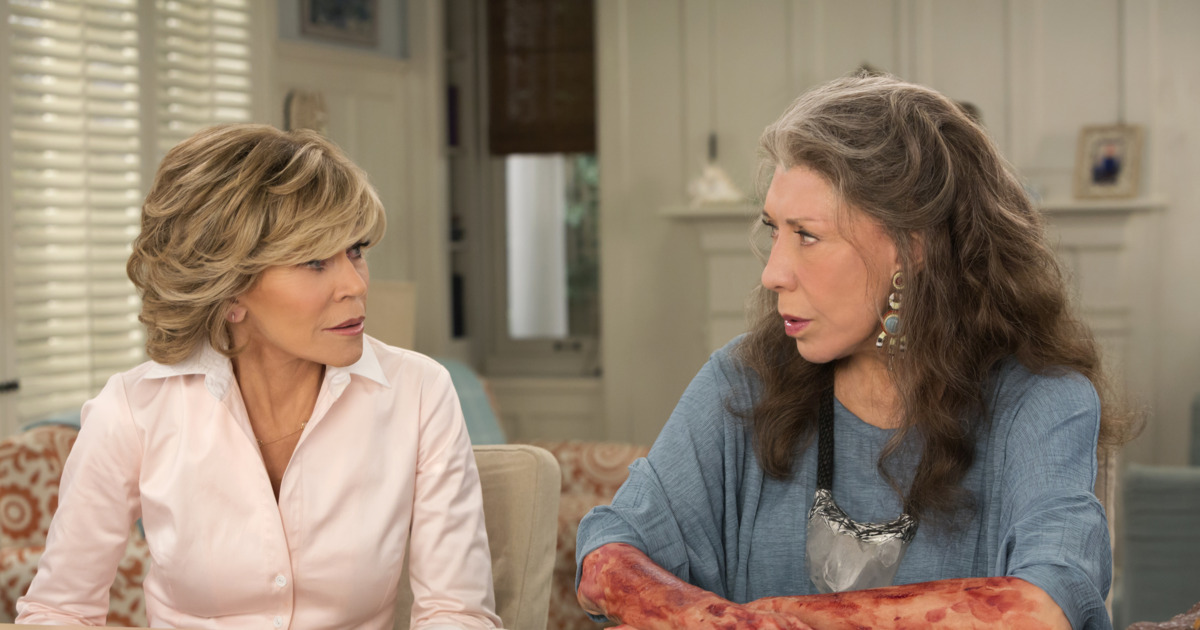 Jane Fonda and Lily Tomlin looking concerned on an episode of Grace and Frankie