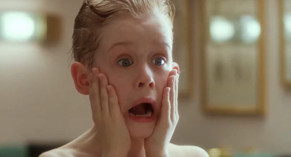 Macaulay Culkin as Kevin screaming with his hands on the side of his face in Home Alone