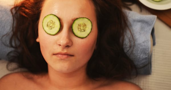 girl with cucumber eye mask relaxing self care, period care packages ideas, treat yo self