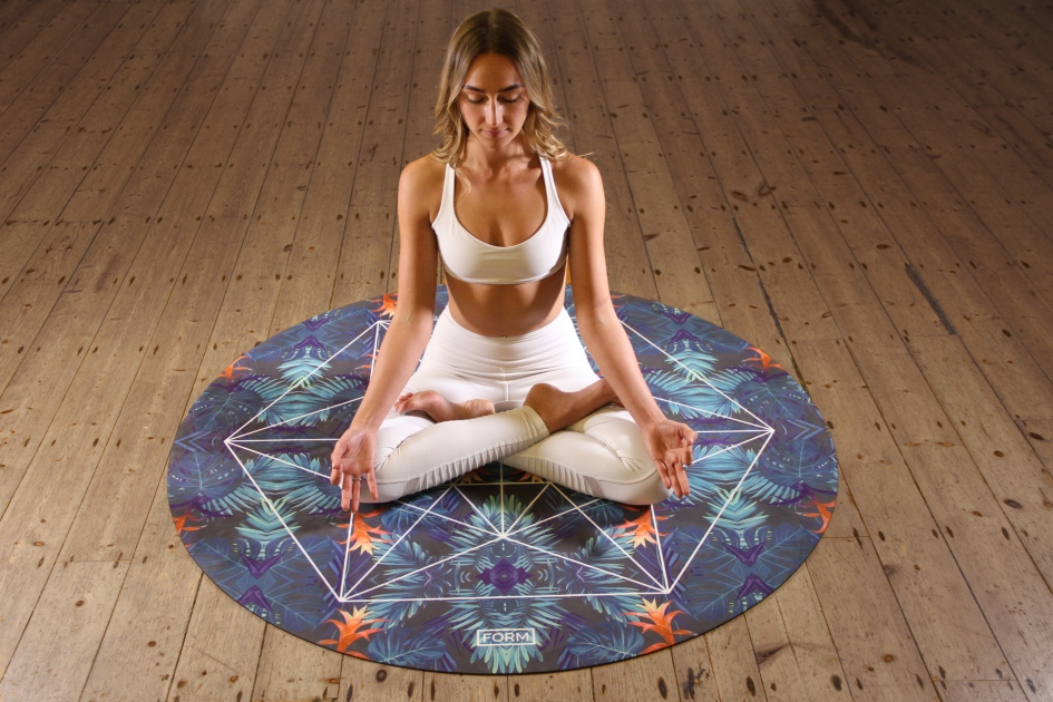Woman practicing the Lotus position, one of the many yoga poses.