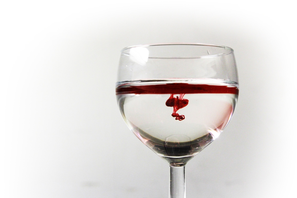 Red dye in a wine glass full of water.