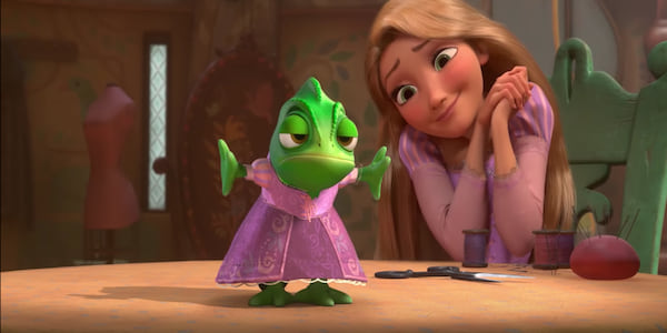 Rapunzel from Disney's Tangled looking lovingly at Pascal who she put in a dress., movies
