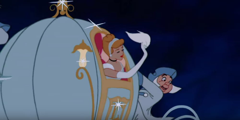 Disney's Cinderella waving a handkerchief from her carriage going to the ball., movies