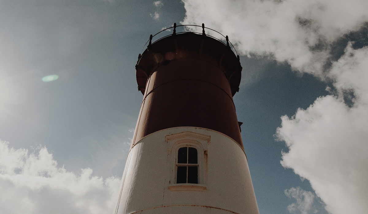cape cod instagram captions, lighthouse in front of blue sky