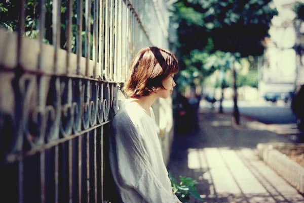 girl leaning on gate
