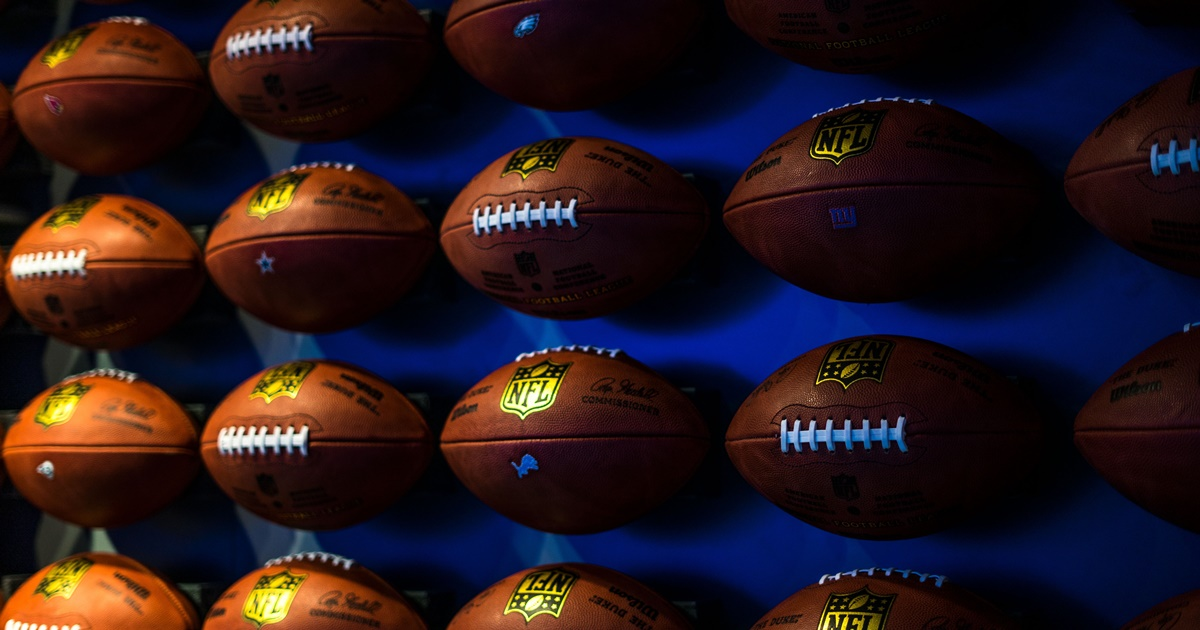 rows upon rows of footballs attacked to a wall with a blue background, dallas cowboys instagram captions, culture