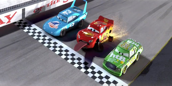 Lightning McQueen from Pixar's Cars barely crosses the finish line by sticking out his tongue., movies