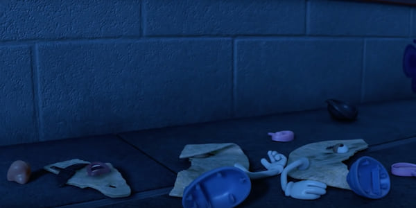 The tortilla version of Mr. Potato Head is on the ground in pieces spread out everywhere., movies