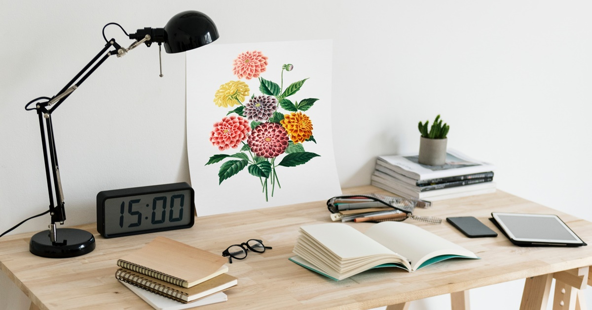 and various other things, workspace instagram captions, Photo of a workspace, a light brown wooden desk covered with notebooks, books, a pair of glasses, a clock, a lamp, a flower print, career