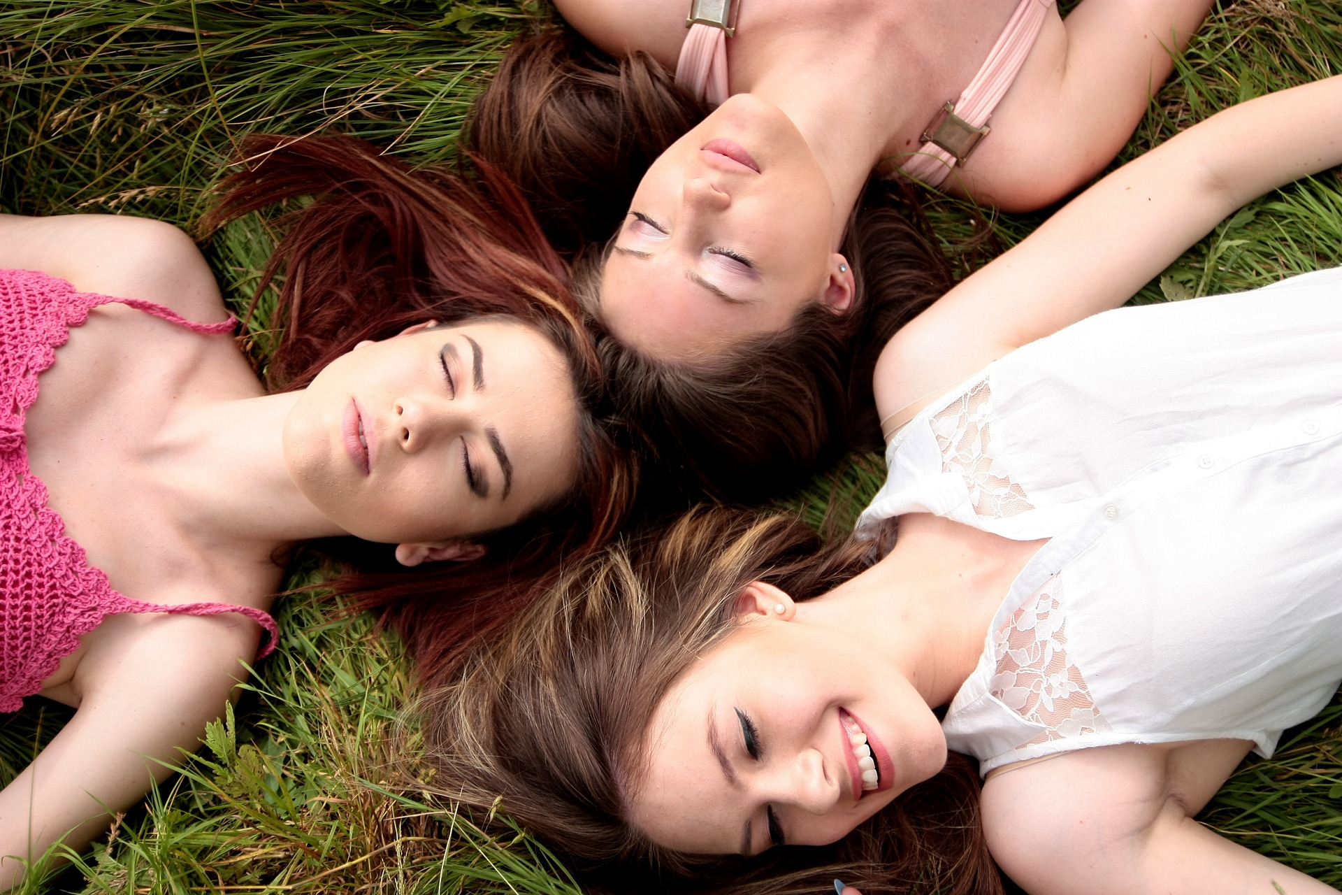 ride or die instagram captions, three girl laying in the grass, smiling, instagram captions