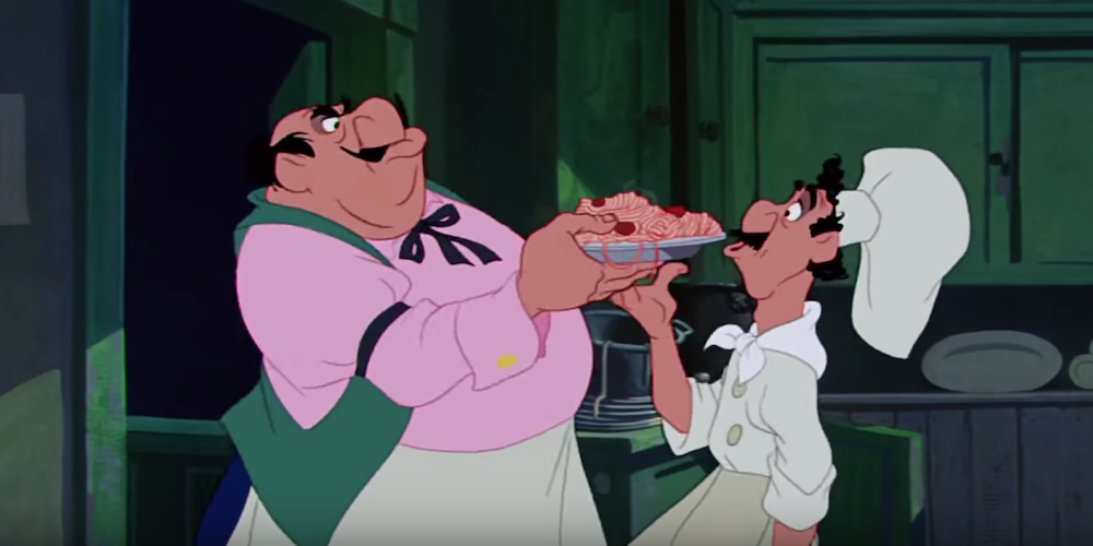 The restaurant owner and chef from Disney's Lady and The Tramp pass the plate of spaghetti between them., movies