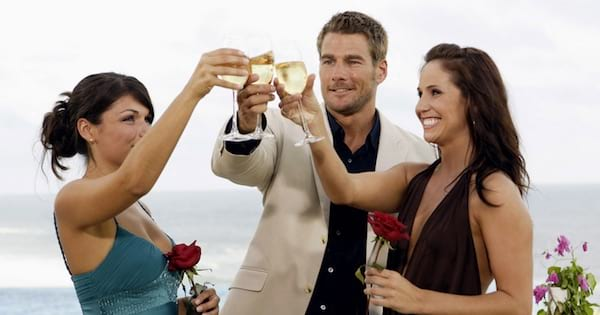 Brad Womack and girls making a toast outside smiling the Bachelor season 11