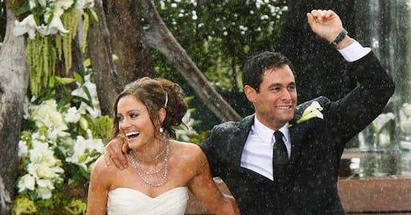 Jason Mesnick and Molly Malaney holding hands getting married in the rain The Bachelor Season 13