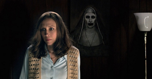 woman stands with demon ghost behind her haunted The Conjuring