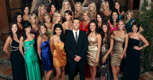 Season 14 The Bachelor surrounded by contestants