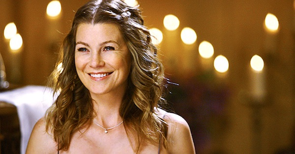 Meredith Grey smiling lights behind her Grey's Anatomy