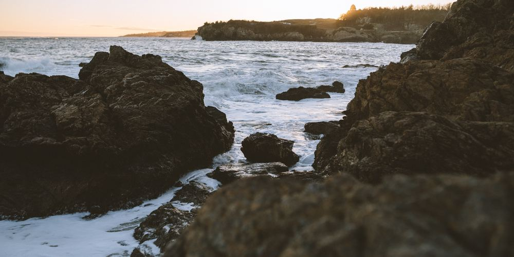 Sea waves crashing on rocks during sunset, travel, rhode island instagram captions