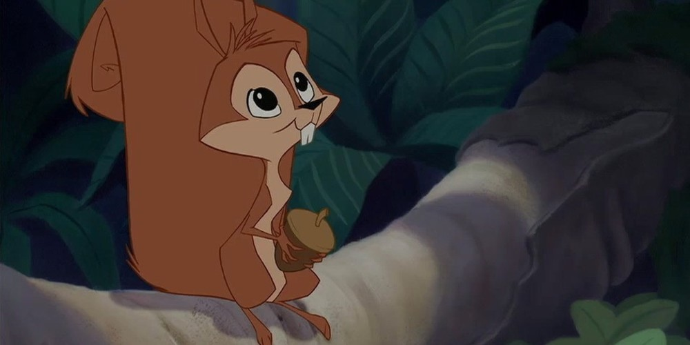 Bucky from Disney's The Emperor's New Groove standing on a branch holding an acorn., movies