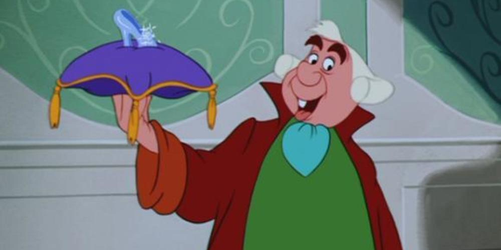 The Herald from Disney's Cinderella holding up a pillow with a glass slipper, movies
