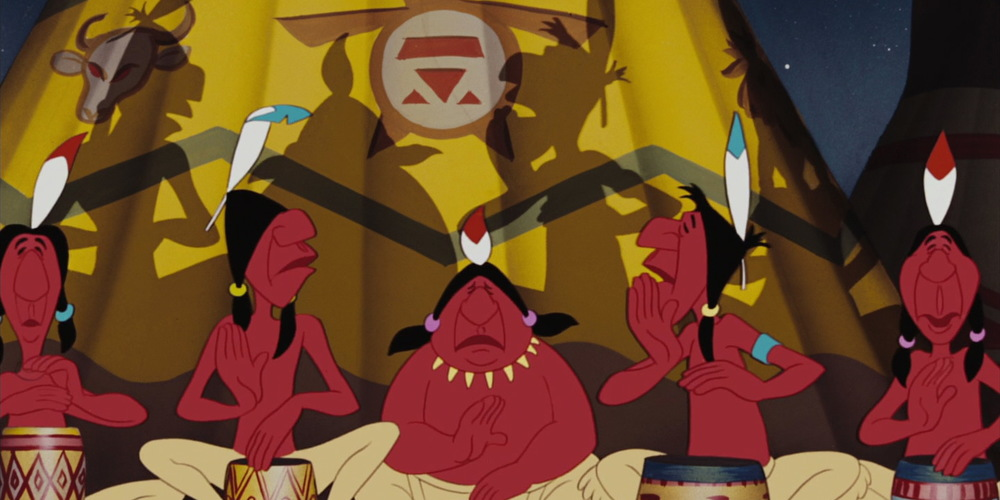 Indians from Disney's Peter Pan sit in front of tents while playing drums, movies