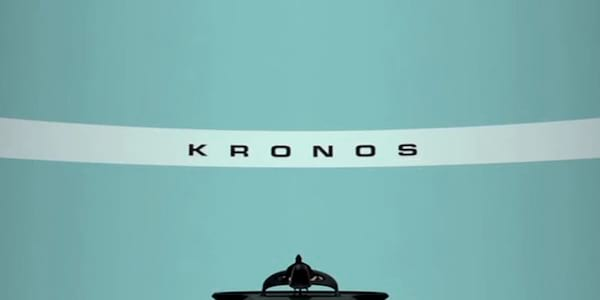 A person sitting at a control station in front of an over-sized screen with the word KRONOS showing from Pixar's The Incredibles, movies