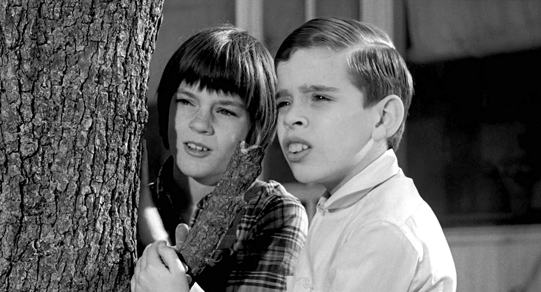 Scout and Dill in To Kill A Mockingbird
