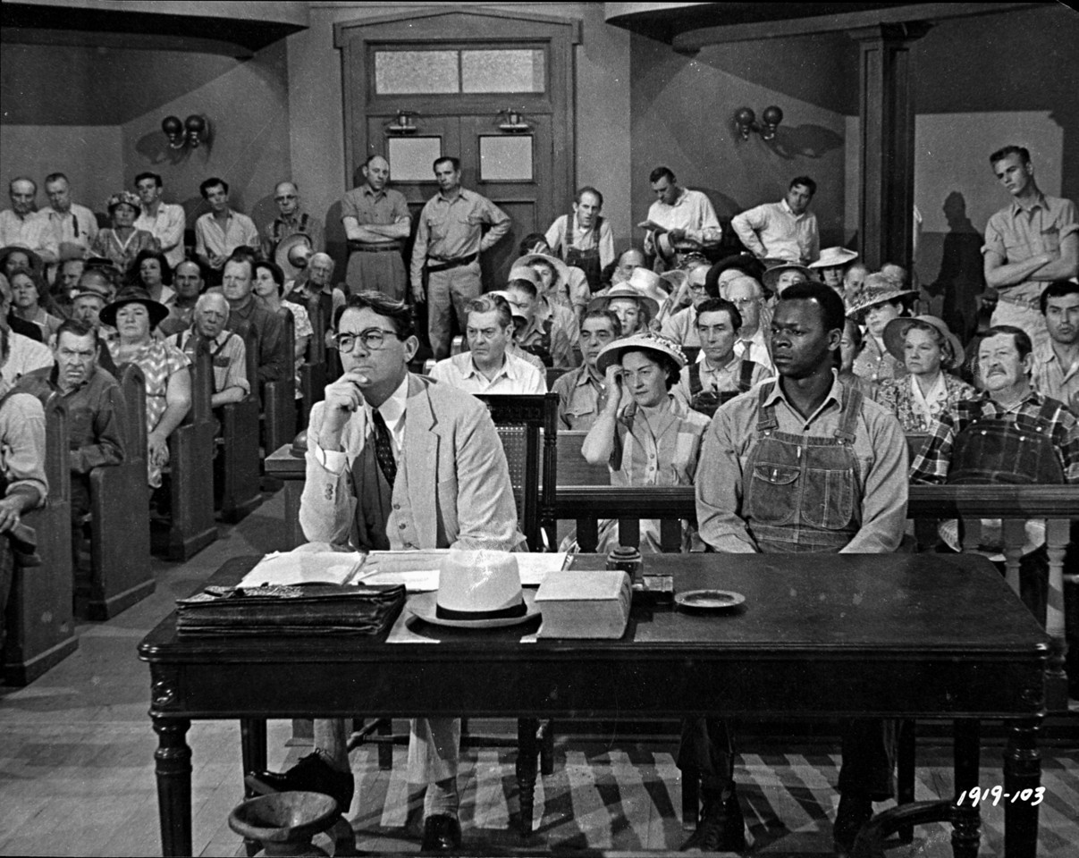 Atticus and Tom sitting during the trial