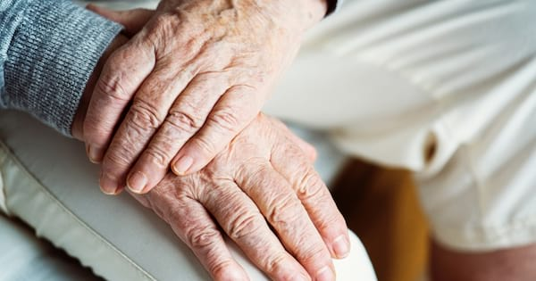 A close up image of an elderly person's hands.