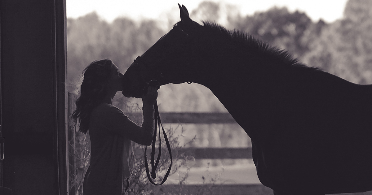 equestrian instagram captions, girl kissing her best friend horse in a sweet black and white photo