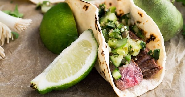 Taco Instagram captions, closeup of a taco resting next to a lime, food & drinks