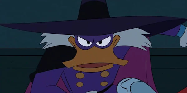 Disney's Darkwing Duck crouching confidently wearing his signature attire, movies