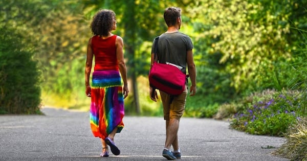 man and woman walking outside near trees, health fitness, fitness