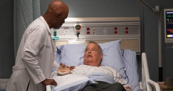Richard Webber caring for patient leaning over hospital bed, Grey's Anatomy season 15