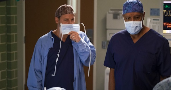 Alex Karev and Richard Webber holding scrub masks to face, Grey's Anatomy season 15