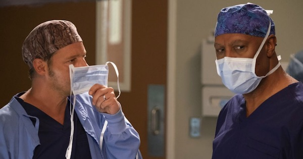 Richard Webber and Alex Karev holding scrub masks to faces, Grey's Anatomy 092518