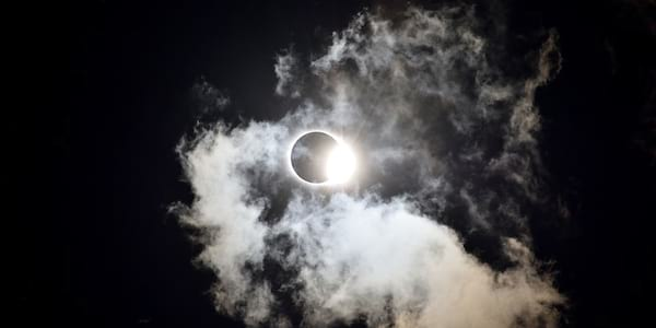 The moon passing over the sun in a solar eclipse, eclipse instagram captions