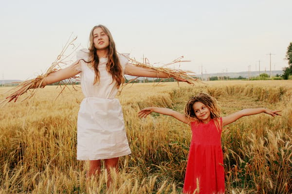 a woman and little girl dressed as scarecrows in a field, scarecrow instagram captions