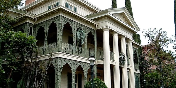 The Haunted Mansion exterior at Walt Disney World theme parks during the daytime.