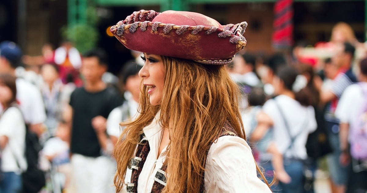 Pirate costume Instagram captions, woman with ginger hair turned in profile dressed as a pirate, culture