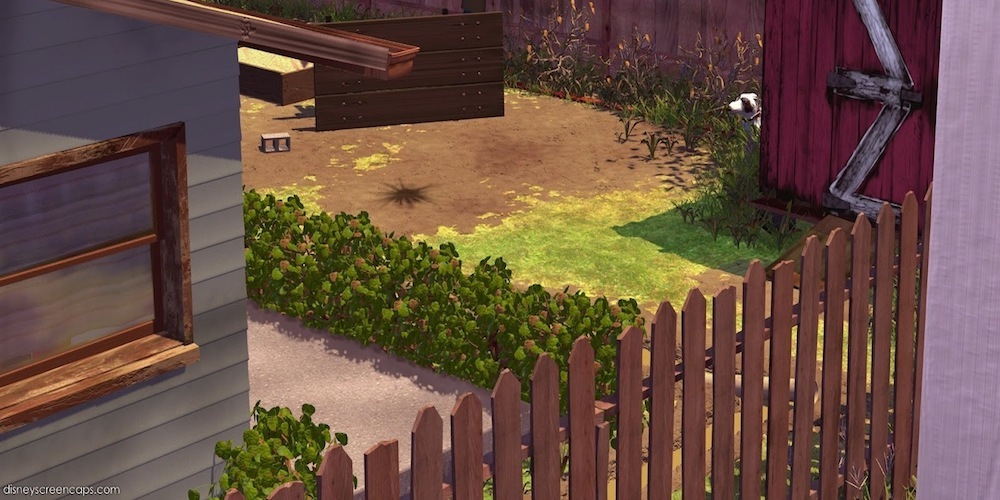 A view of Sid's backyard with a bald patch of grass and an overturned table from Pixar's Toy Story., movies