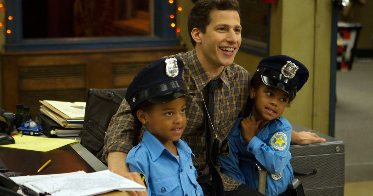 Cop costume Instagram captions, Peralta from Brooklyn Nine-Nine holding Cagney and Lacey as they are dressed like cops, culture