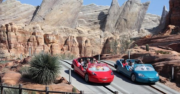 Cars from the movie on race track with people inside them at California Adventure, Disney Park ranking