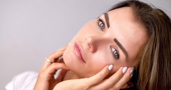woman's face tilted sideways with hands on cheeks, Best Skincare brands ranking, best skincare brands for women