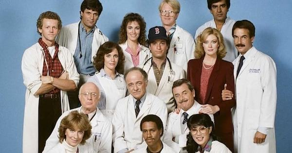 cast of St. Elsewhere lined up posing smiling in lab coats, best medical shows tv ranking