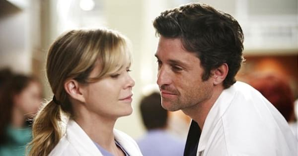 Meredith and Derek close together almost kissing on Grey's Anatomy, best medical show tv ranking