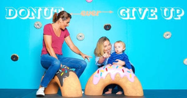 A family experiencing L.A.'s newest interactive museum Cheat Day Land