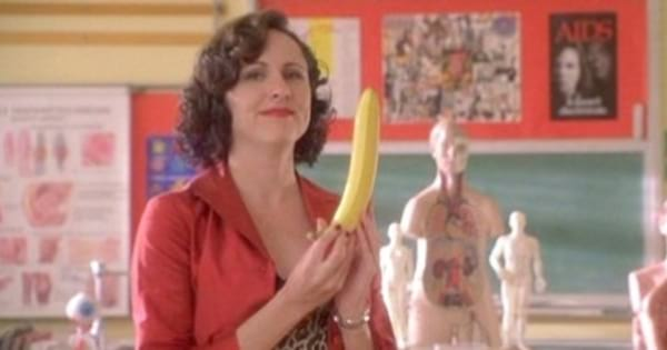 Molly Shannon putting a condom on a banana in Never Been Kissed