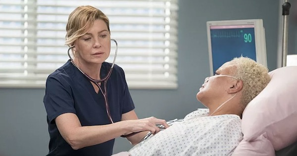 Meredith Grey listening on stethoscope to Cece in hospital bed, Grey's Anatomy season 15