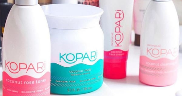 A collection of Kopari Beauty's various products sitting on a bathroom sink