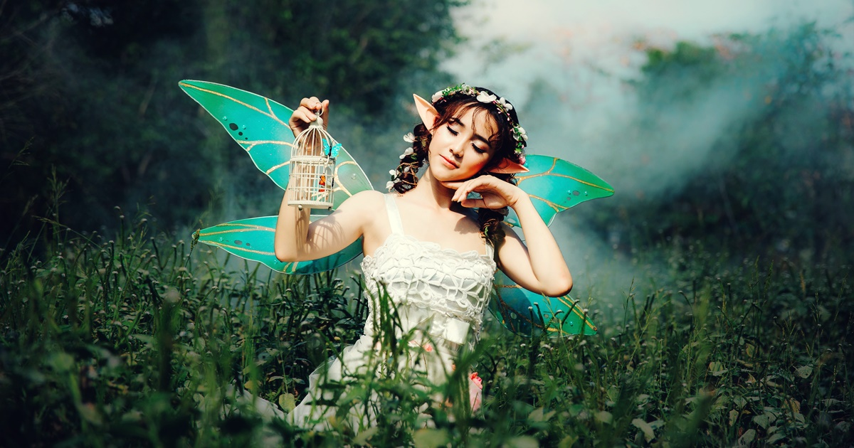 Costume Instagram captions, photo of an Asian woman kneeling in the grass in a fairy costume, culture, fashion